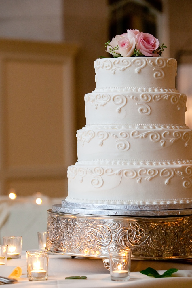 Sweet Fest discusses Cottage Food Laws. Article shows image of wedding cake.